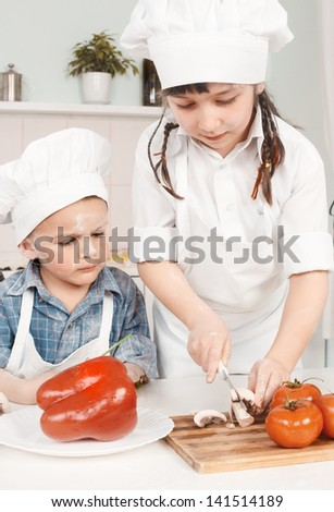 young chef preparing vegetables in the kitchen - stock photo