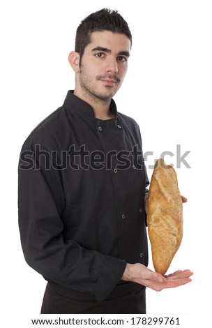 Young cheff holding a loaf of bread on white background - stock photo