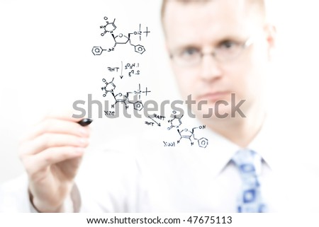 young chemist writing organic chemistry reaction equation, selective focus - stock photo