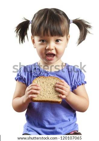Young child about to eat sandwich. Picture isolated on white background. - stock photo
