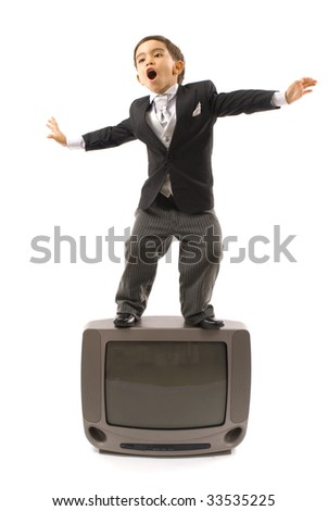 Young Child and a old TV . - stock photo