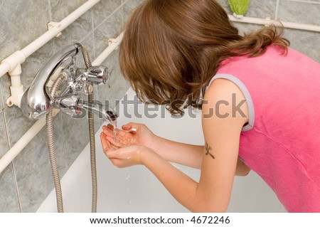 Young child brushing her teeth in bathroom - stock photo