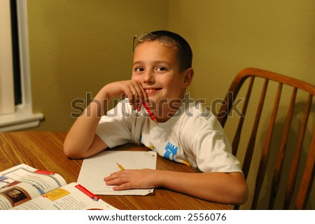 Young child doing homework - stock photo