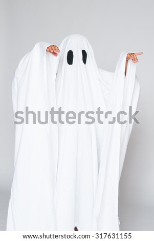 young child dressed in a ghost costume for halloween - stock photo