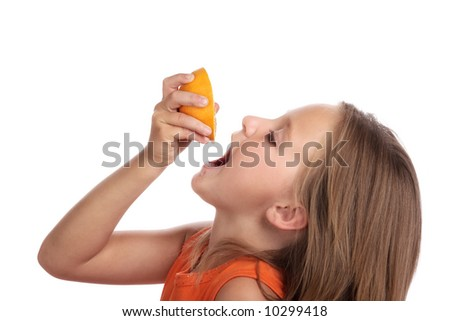 Young child drinking juice from fresh orange