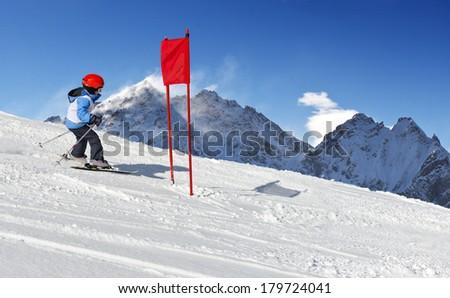 Young child during his ski school slalom run  - stock photo