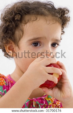 Young Child eating a red apple .
