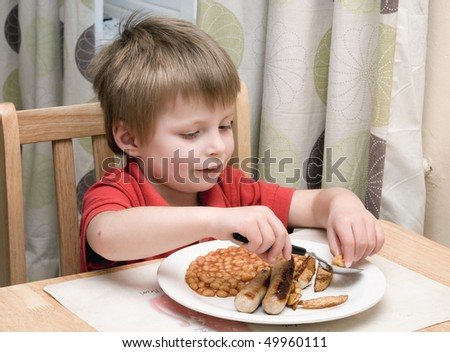 Young child eating unhealthy food. - stock photo