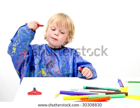 Young child getting an idea, ready to start his drawing