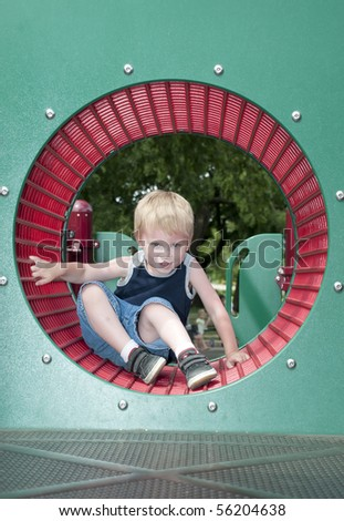 young child having fun and playing in the park on a sunny day