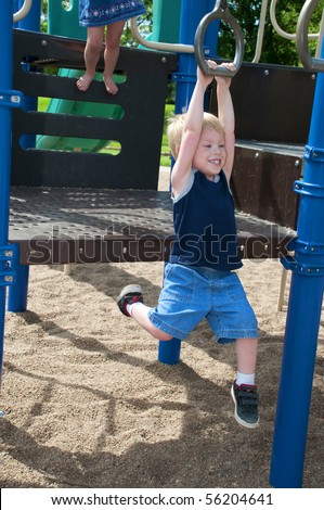 young child having fun and playing in the park on a sunny day - stock photo