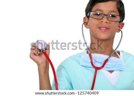 Young child holding a stethoscope - stock photo