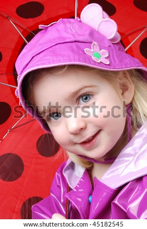 young child holding an umbrella - stock photo