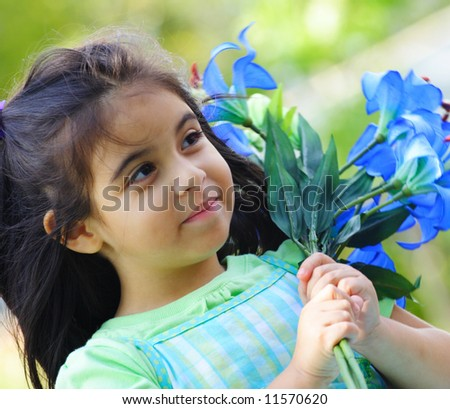 Young child holding flowers - stock photo