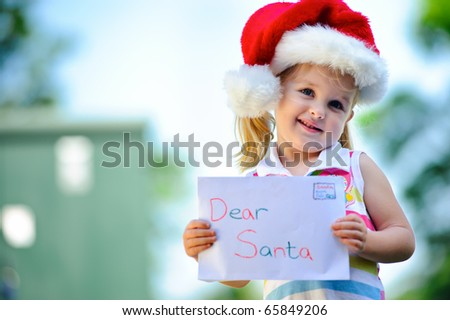 Young child holds letter for Santa Claus - stock photo