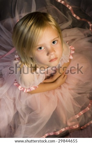 Young child in ballet dress from above - stock photo