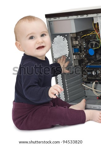 young child in blue shirt with open computer on white background