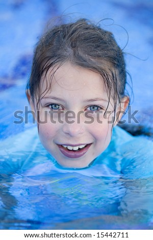 Young Child in Swimming Pool Smiling