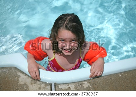 Young Child in Swimming Pool Water - stock photo
