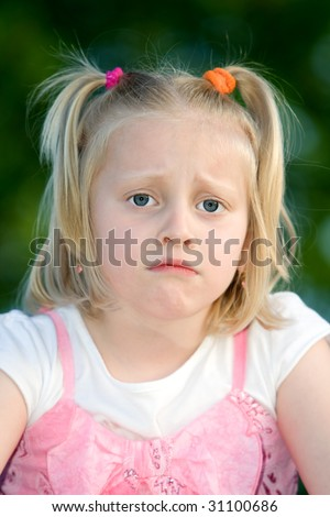 Young child is sad - stock photo