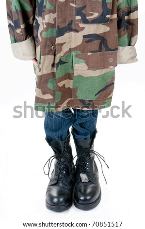 young child playing dress up in parent's uniform - stock photo