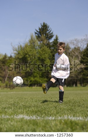 Young Child Scoring Soccer Goal