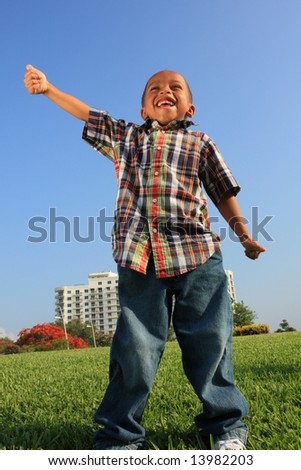 Young Child Showing Thumbs-Up Gesture - stock photo