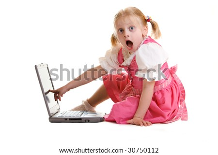 Young child sitting on computer and finding something exciting - stock photo
