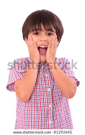Young child surprised with hands on his face, over white background. Six years old - stock photo