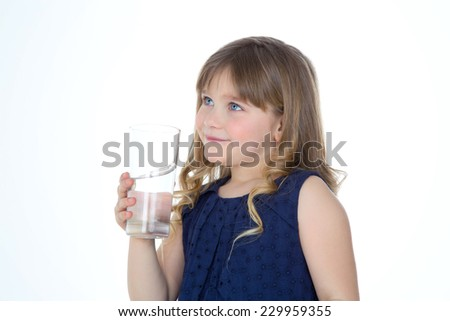 young child with a glass of fresh water - stock photo