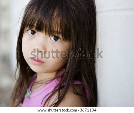 Young Child with a Sad Expression