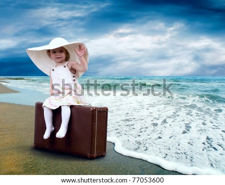 Young child with baggage on the tropical beach - stock photo