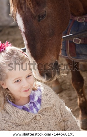 Young child with brown pony - stock photo