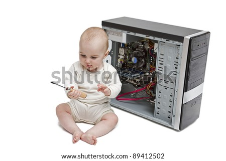 young child with screwdriver in hand working on open computer in white background.