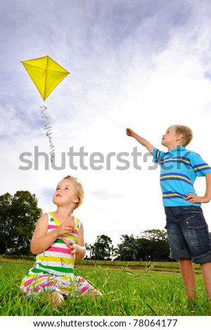 Young children having fun with their kite - stock photo