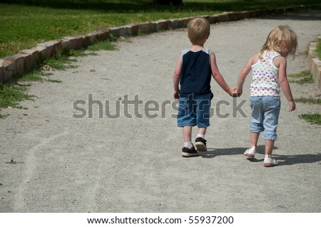 young children in the park playing and having fun - stock photo