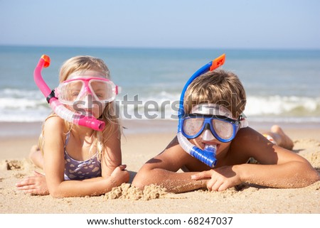 Young children on beach holiday - stock photo