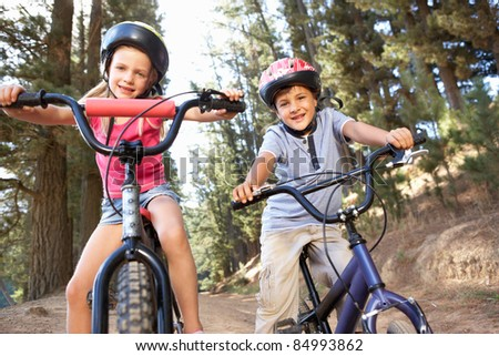 Young children on bikes in country - stock photo
