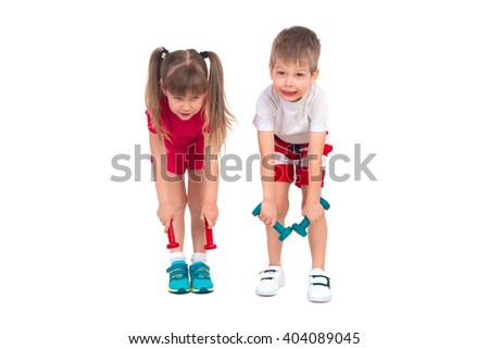 Young children with dumbbells perform gymnastic exercises - stock photo