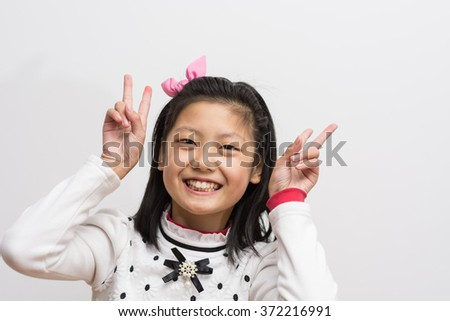 Young chinese cute smiling girl  - stock photo