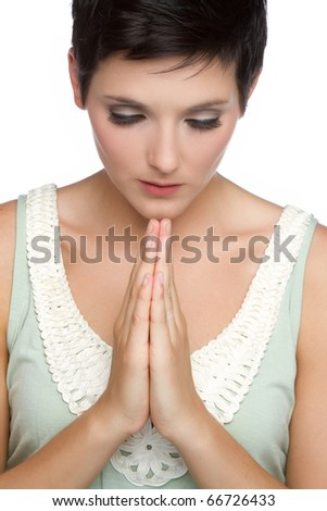 Young christian religious woman praying