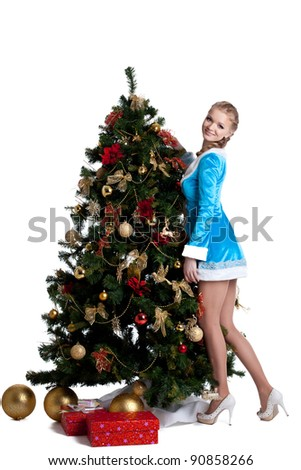 Young christmas girl decorate new year fir tree - stock photo