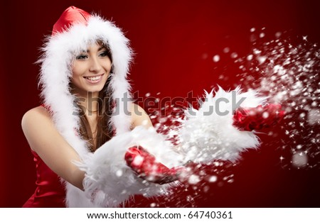 young christmas woman holding star over red background