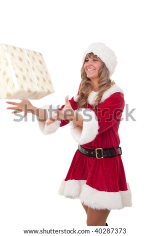 young christmas woman in red santa claus dress is catching a christmas present - stock photo