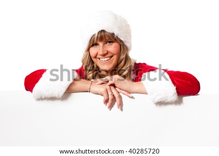 young christmas woman in red santa claus dress on a copyspace label - stock photo