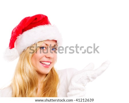young christmas woman pointing at copyspace over white