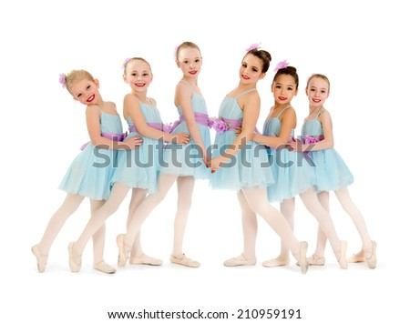 Young Class of Ballerina Dancers Pose for Recital Photo - stock photo