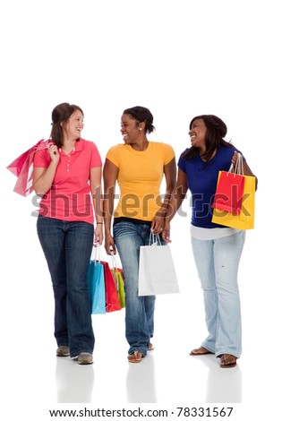 Young college age ladies/friends with shopping bags on white background - stock photo