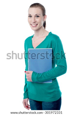 Young college student posing with notebook - stock photo