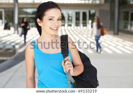 Young college student standing outside